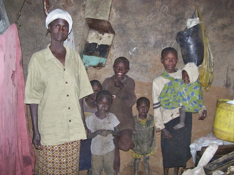 Ester (far right) with her family in their home