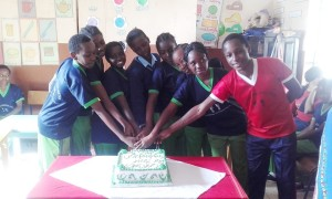 Class 8 Kids Pose with their cake