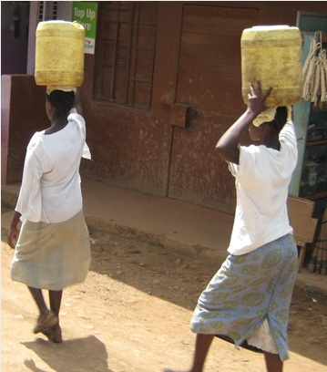 Without running water, families in the slums must carry all their water, often from far away