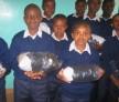 Kids receiving new uniforms