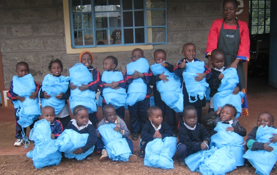 Youngest Tenderfeet children with their new nets. These little ones are the most vulnerable to Malaria