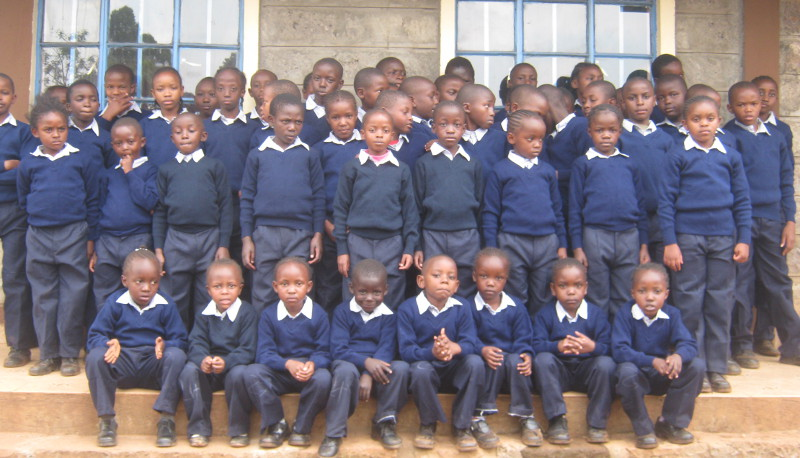 A group of Tenderfeet students show off their new uniforms